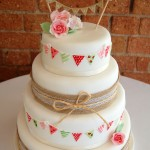 Hessian, lace and bunting wedding cake